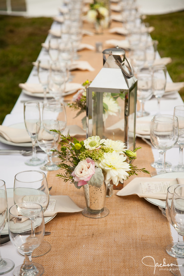 long tables with brown table cloth green flowers