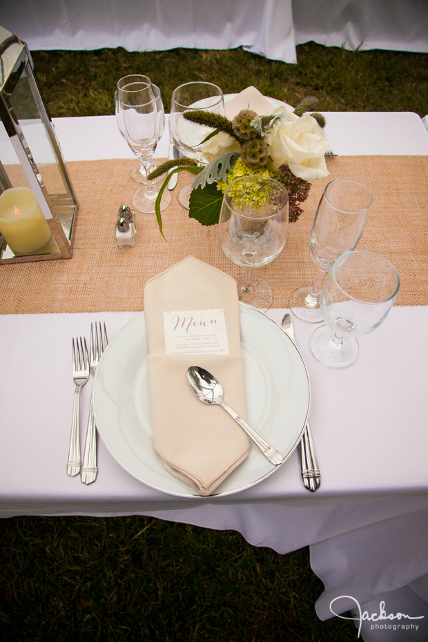 wedding plate set up with brown white and green