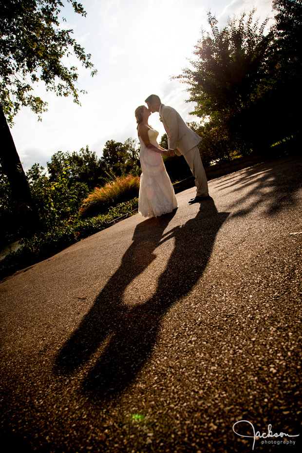 long shadow of bride and groom