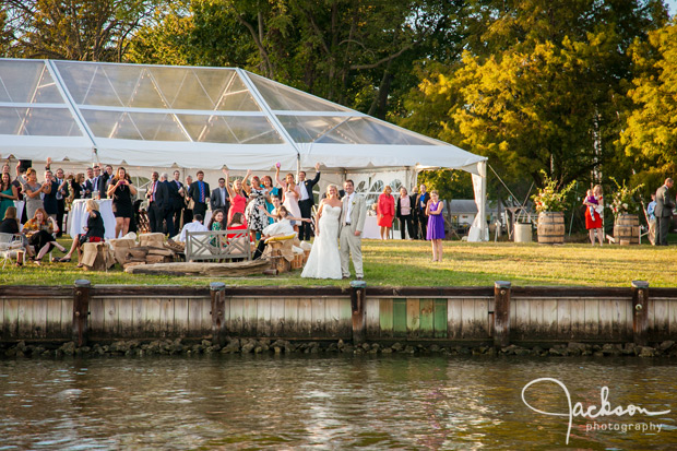 bride and groom by the water at reception