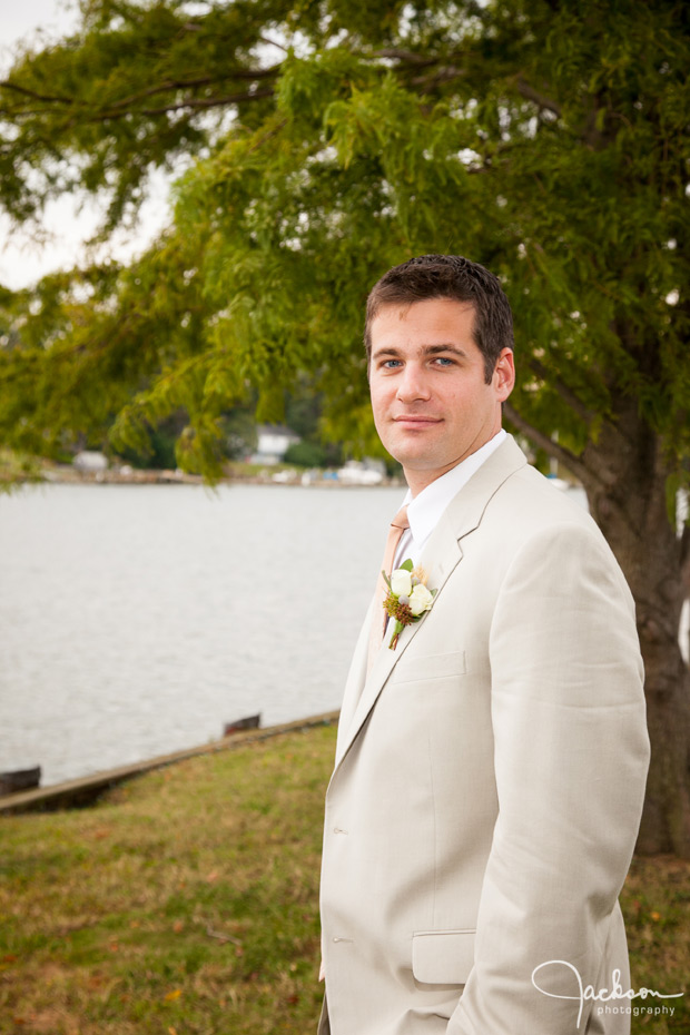 portrait of groom by the water