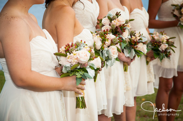 bridesmaids with brown dresses and green bouquets