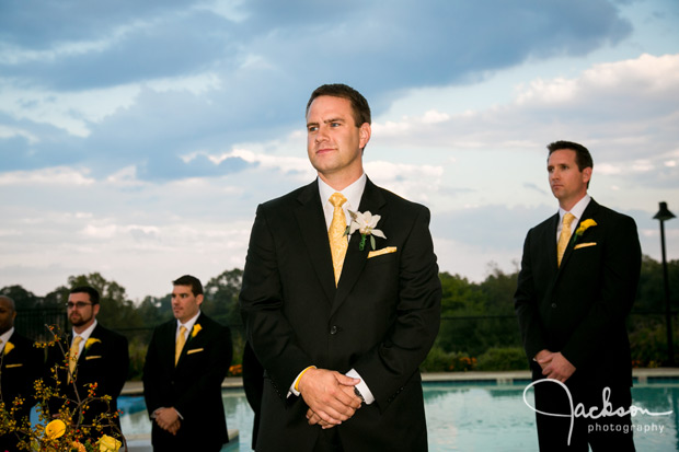groom awaiting bride with storm clouds behind him