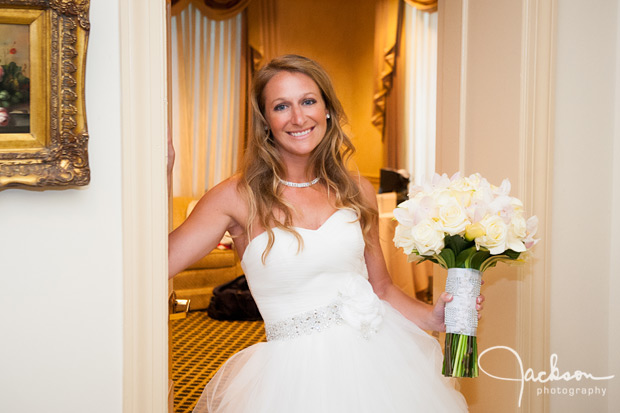 bride in doorway with yellow flowers