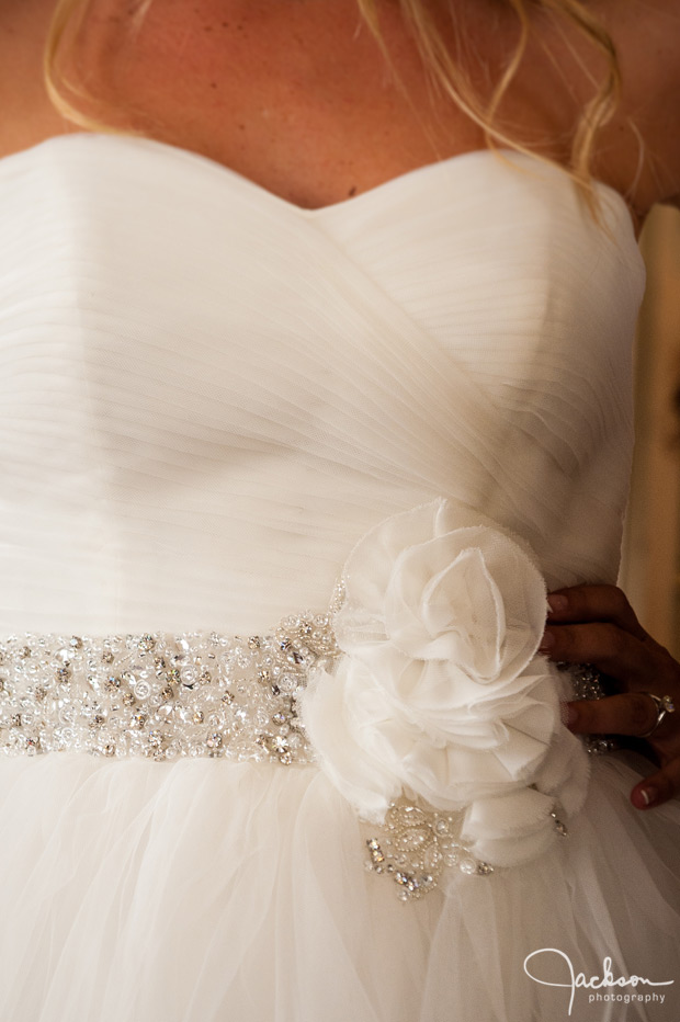 detail of beaded flower on bride
