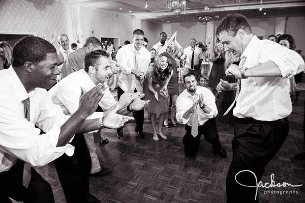 groom dancing with groomsmen