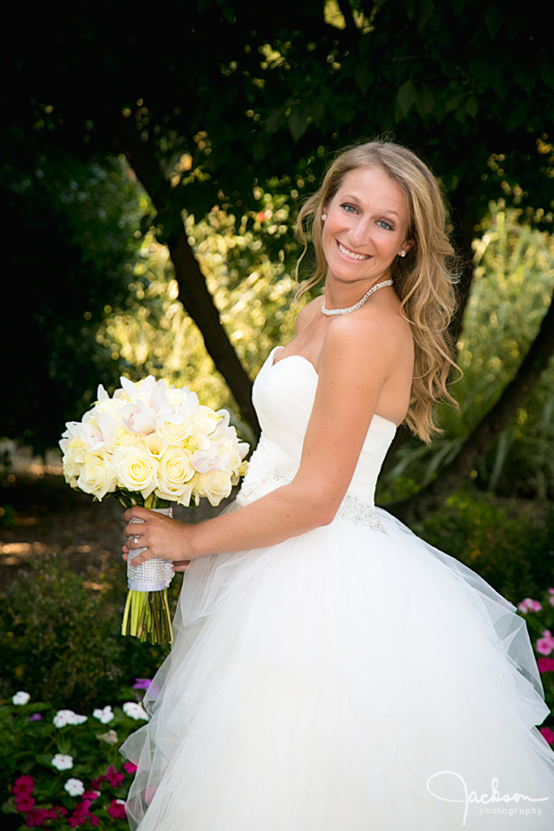 bride posing with cream and yellow bouquet