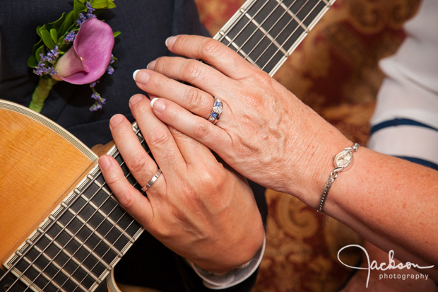 bride and groom's hands on guitar