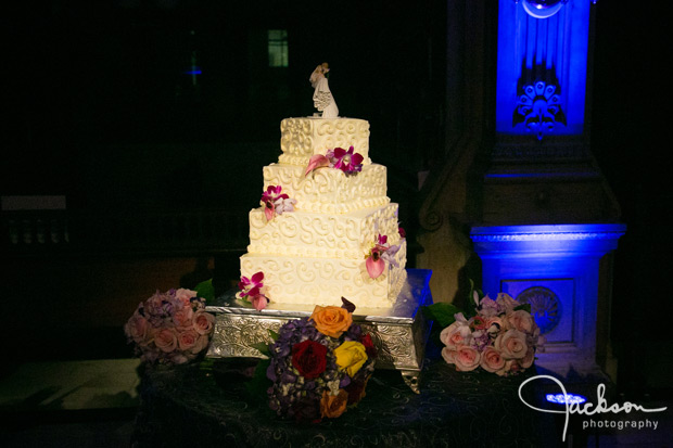 swirled square wedding cake with purple orchids