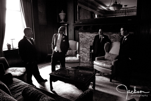 groom and groomsmen dramatic light