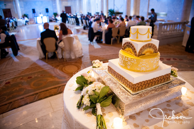 square gold and white ornate wedding cake