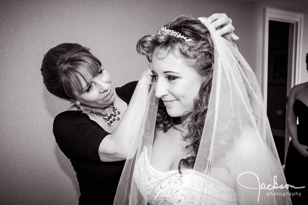 mother putting bride's veil on