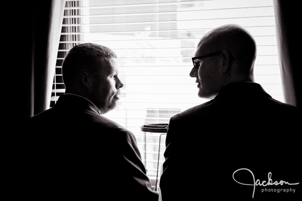 groom and groomsman looking out window