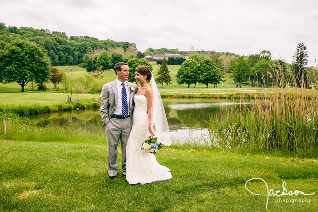 bride and groom by water golf course