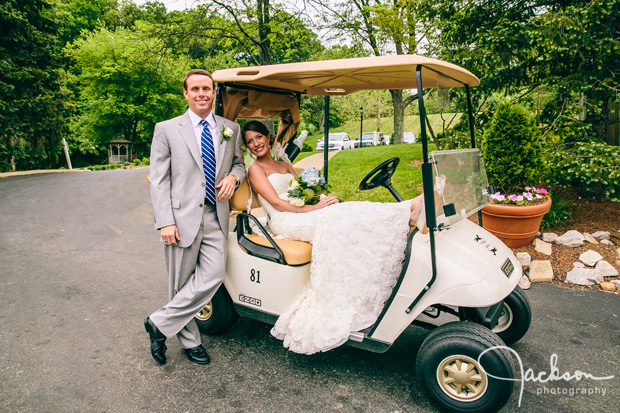 bride and groom on golf cart